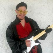 Josh wearing gold shutter style stars