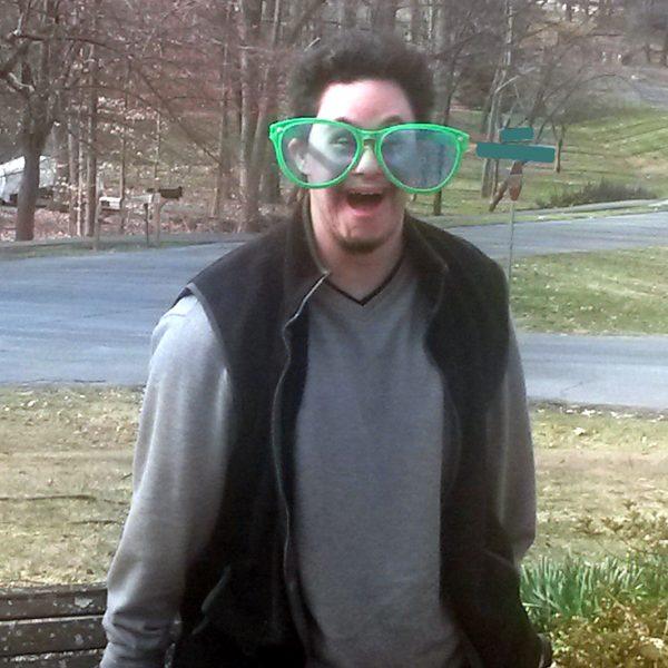 Josh wearing green jumbo shades