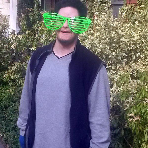 Josh wearing jumbo shutter style shades