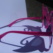 Pink butterfly glasses on Rock Star Shades