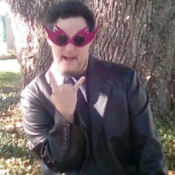 Josh wearing Dark pink lightening glasses on Rock Star Shades
